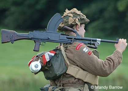Soldier carrying a gun